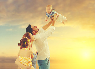 happy family of father, mother and two children, baby son and da