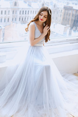 Bride in a tender light blue wedding dress in a morning. Fashion beauty portrait