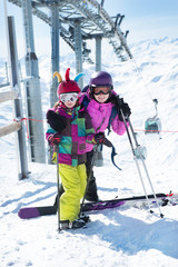Mother and daughter with skis