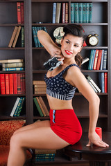 pinup woman with retro camera posing