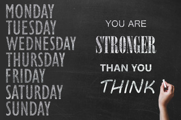 written message 7 day of week on chalk board background and sport motivation text