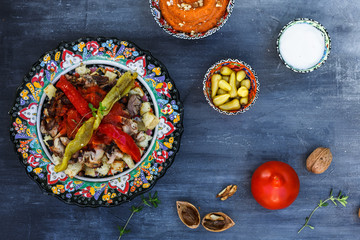 Iskender kebab - turkish food in traditional dishes, top view