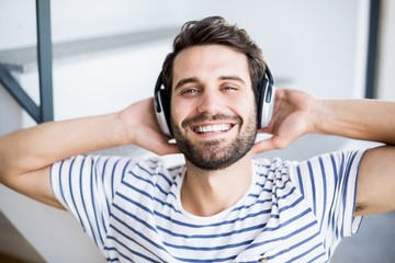 Man relaxing and listening to music on headphone