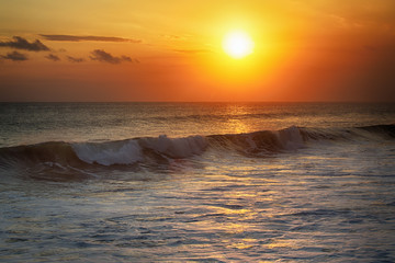 Sunrise in the sea with soft wave and cloudy