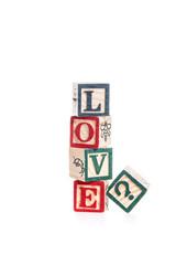 photo of a alphabet blocks spelling LOVE? isolate on white backg
