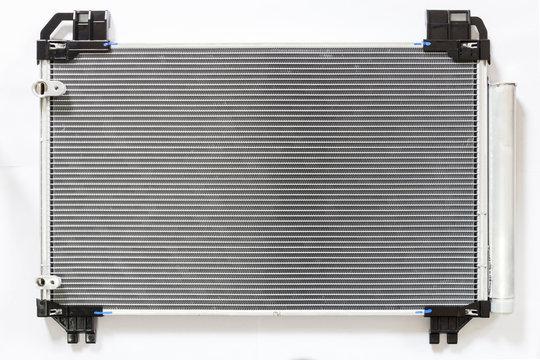 Car condenser radiator on white background. Radiator top view of