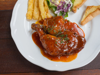 deep-fried chicken with bbq sauce, potato and salad
