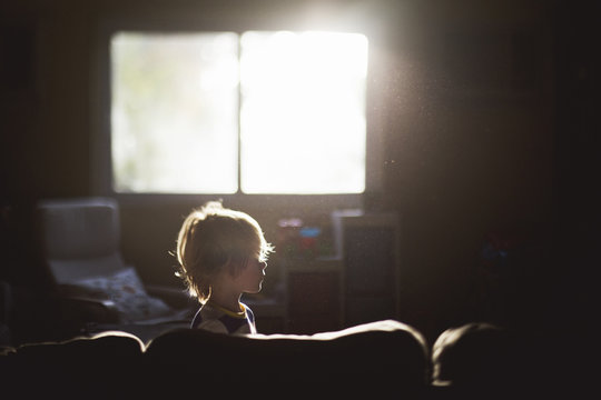 Profile of Boy on Couch in Pretty Morning Light