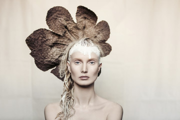 Woman with leaf headdress, portrait
