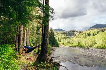 Man in Hammock By River, Mountain Loop