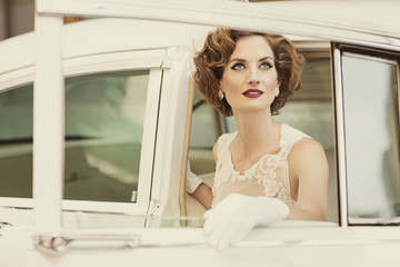 Glamorous woman getting out of a car