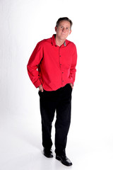 Caucasian middle aged man in red shirt white background