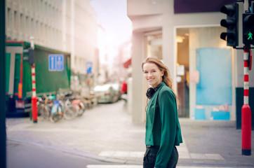 Smiling woman walking in the street