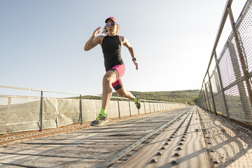Athlete running and jumping on a bridge