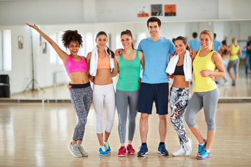 Group photo of smiling sporty people on fitness class
