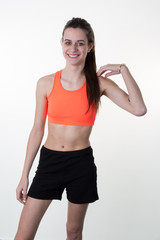 A very skinny woman wearing sport wear with long hair