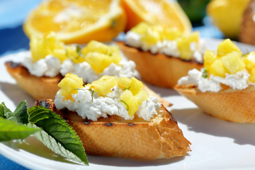 tosts with cottage cheese and pineapple on a plate