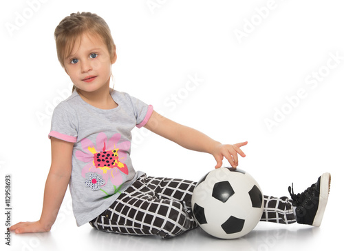 9d45ed3c8 little blonde girl sitting on floor with soccer ball - Isolated on white  background