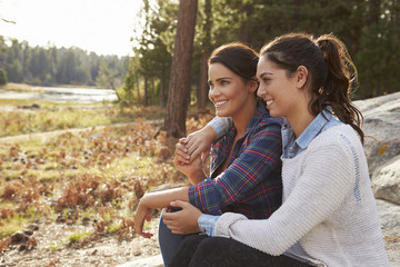 Happy lesbian couple relaxing in the countryside