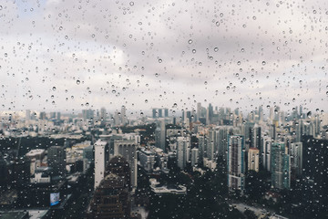 After the rain - Raindrops on a window overlooking the cityscape.