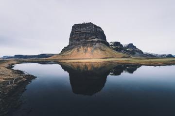 Reflection triplet - Trio of mountain peaks reflection on still lake.