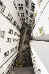 High angle view of vehicles parked amidst residential buildings