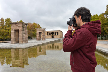 Tourist making pictures of Debod Temple in Madrid, Spain