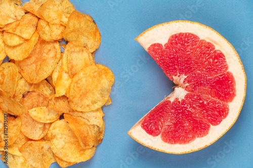 Potato chips versus juicy red grapefruit  Poor nutrition and healthy