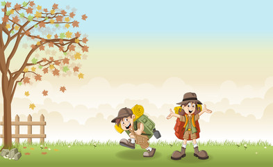 Cute cartoon kids in explorer outfit on a green park