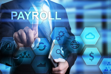Businessman pressing button on touch screen interface and select payroll. busines concept.
