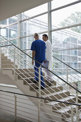 Medical workers walking up a staircase in a hospital