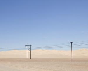 Desert landscape and electric pylons in Yuma, Arizona