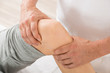 Close-up Of Therapist Doing Knee Massage