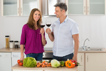 Portrait Of Happy Couple Toasting Red Wine