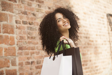 Happy afro woman with shopping bags