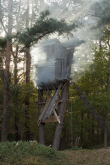 A hunting tower in a forest