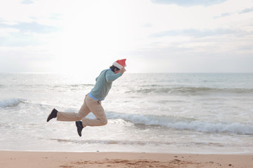 Superman Santa Claus flying over sea beach and sky