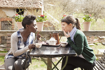 Two women having coffee and gossiping