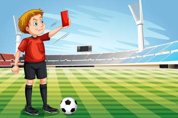 Referee showing red card in the football field