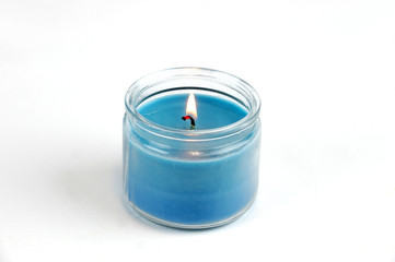 candle flame fire of decorative blue candle on white background