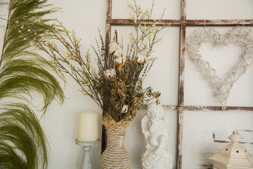 Vase with twigs, Ceramic angel