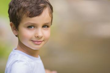 Portrait of a cute little boy in a white t-shirt