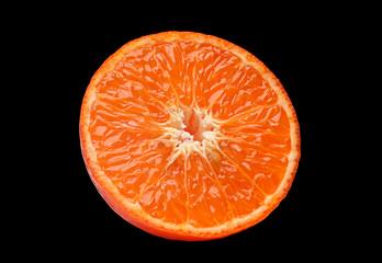 Orange fruit part on black