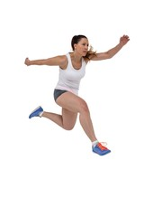 Athletic woman running on white background