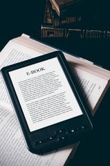 E-book reader device on desk in library