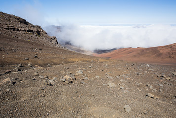 Looking inside the Haleakala Crater with clouds rolling in. View from the sliding sands trail