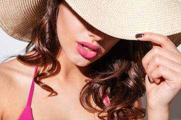 Close-up portrait of an attractive woman in beach hat