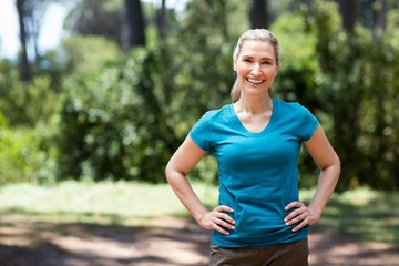 Woman smiling and posing with hands on hips
