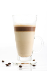 Latte macchiato with coffee beans isolated on white background