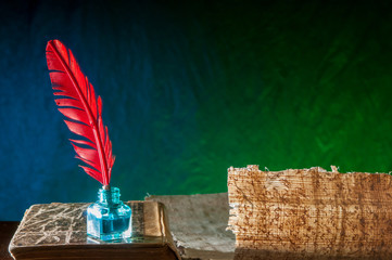 Backlit quill pen and papyrus sheet